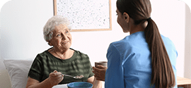 helping older woman with company